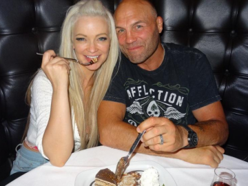 Mindy Robinson and Randy Couture enjoy dinner at the Andiamo Italian Steakhouse